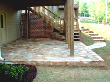 The Natural Stacked Stone Retaining Walls Were Installed With Concrete  Footing, Rebar, Dead Man, And Poured Concrete.